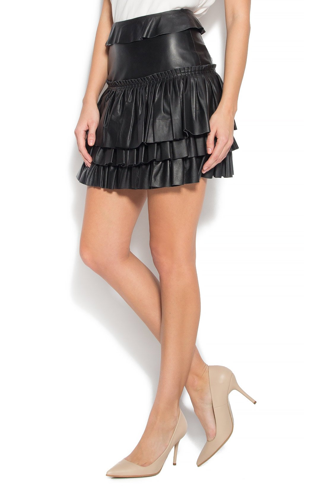 A faux leather skirt with a wrapped ruffle hem. Interior elastic waistband for a secure and comfortable fit. Hidden back zipper with hook-and-eye closure.